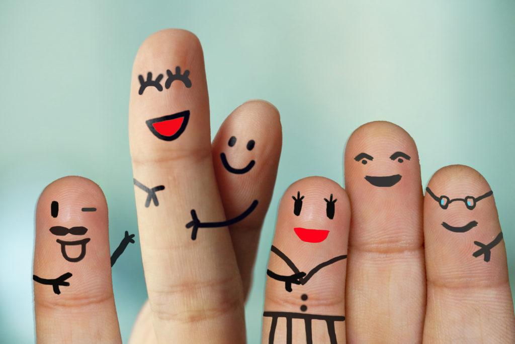 Crossed fingers painted to imply hugging people
